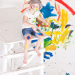 Girl in a cap with paints - Stock Photo