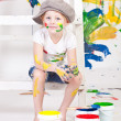 Girl in a cap with paints — Foto de stock #7869734