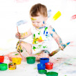 Baby and paints — Stock Photo