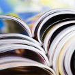 Old magazines with bending pages — Stock Photo #7869984