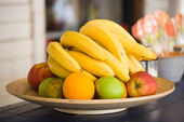 Fruit lies on a wooden dish — Stock Photo