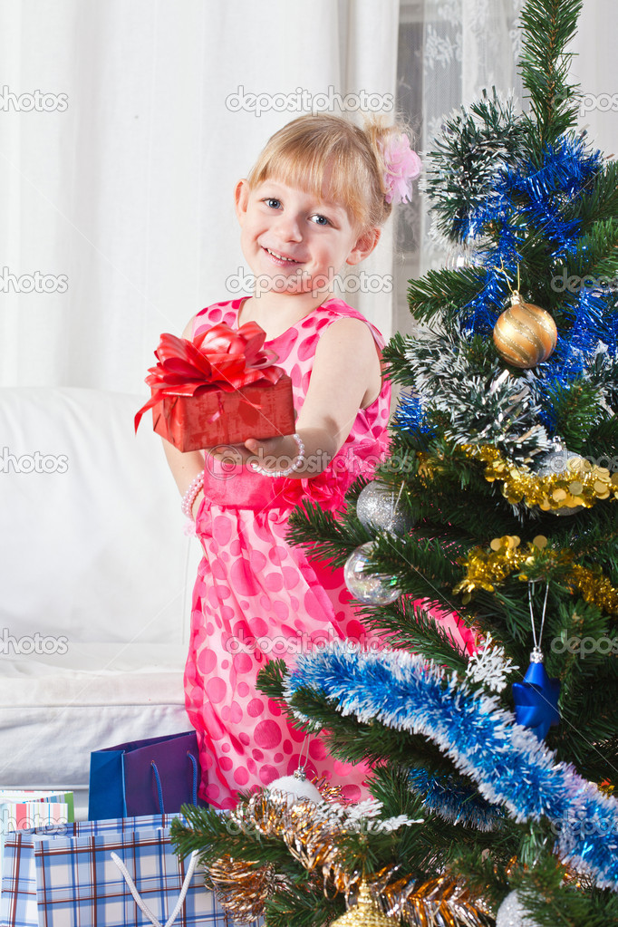 Girl with gifts near a New Year tree — Stock Photo #7869700