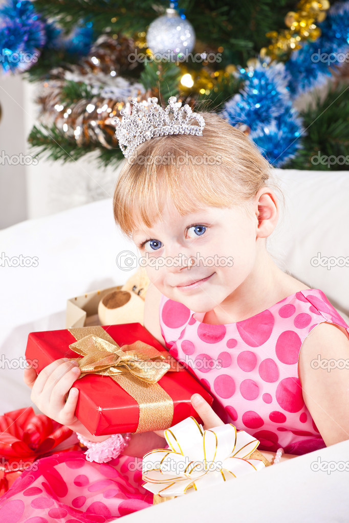 Girl with gifts near a New Year tree — Stock Photo #7869709