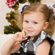 Little girl at a Christmas fir-tree. — 图库照片 #7870640