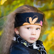 Little girl in a black leather jacket and bandana — Stock Photo #7870680