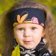 Little girl in a black leather jacket and bandana — Stock Photo #7870682