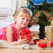 Girl with gifts near a New Year tree — Stockfoto #7870747