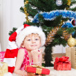 Girl with gifts near a New Year tree — Foto de Stock