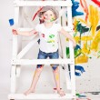 Girl in a cap with paints — Stock Photo #7870769