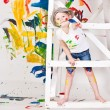 Girl in a cap with paints — Stock Photo #7870770