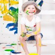 Girl in a cap with paints — Stock Photo #7870777