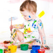 Baby and paints — Stock Photo #7870825