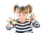 Girl with hands soiled in a paint. — Stock Photo