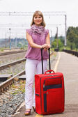 Young woman with a red suitcase — Stock Photo