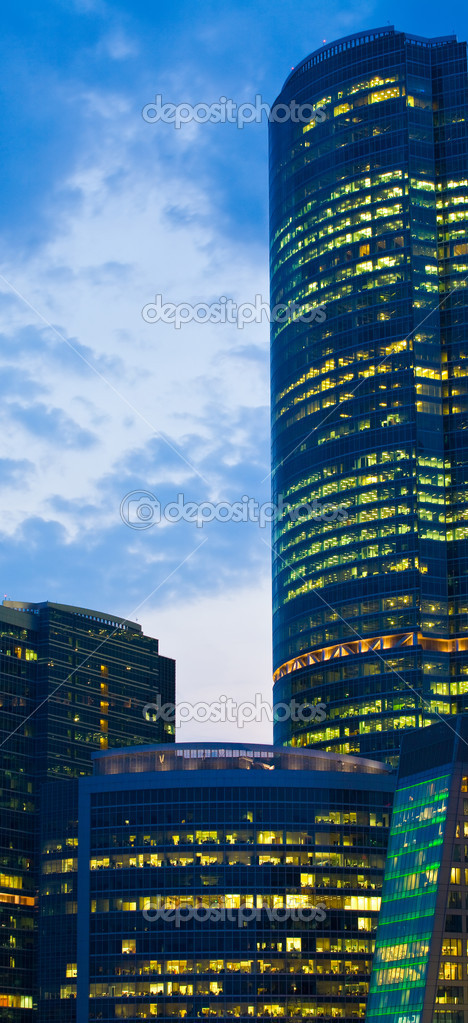 Modern office building at night, skyscraper in moscow, foreshortening from below — Stock Photo #7870563
