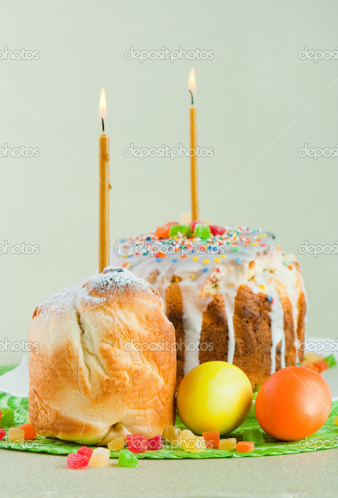 Easter cake with candles on a green background. Easter celebrating.  Stock Photo #7870902