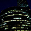 Modern office building at night, skyscraper — Stock Photo