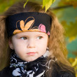 Little girl in a black leather jacket and bandana — Stock Photo