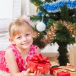 Girl with gifts near a New Year tree — Photo