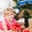 Girl with gifts near a New Year tree — Stok fotoğraf