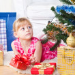 Stock fotografie: Girl with gifts near a New Year tree