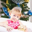 Girl with gifts near a New Year tree — Foto Stock