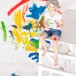 Girl in a cap with paints — Stok fotoğraf