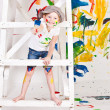 Girl in a cap with paints — Stock fotografie