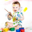 Baby and paints — Stock Photo #7882591