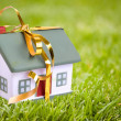 Toy small house with gold bow. — Stock Photo #7882675