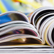 Old magazines with bending pages - Stock Photo