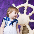 Little girl in a dress in sailor's style — Stock Photo