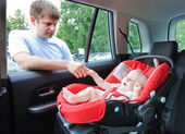 Baby in car — Stockfoto