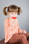 Four-year girl with the big sugar candy — Stock Photo
