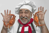 Chef with crabs — Stock Photo