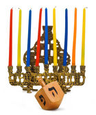 Hanukkal menorah with dreidel — Stock Photo