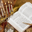 Stock Photo: Hanukkah menorah with candles and torah