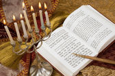 Hanukkah menorah with candles and torah — Stock Photo