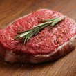 Fresh raw steak with pepper and rosemary - Stock Photo