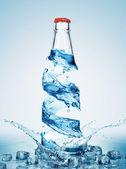 Flaskor i vatten virvel — Stockfoto