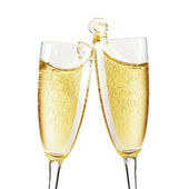 Pair of champagne flutes making a toast. — Stock Photo