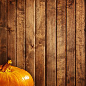 Background with pumpkin on wooden board — Stock Photo