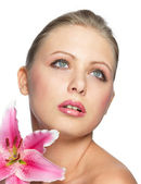Beautiful young pretty woman with flower — Stock Photo