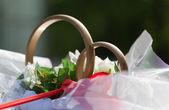 Big wedding ring in a car — Stock Photo