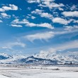 Panoramic landscape of snowy mountains — Stock Photo