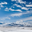 Panoramic landscape of snowy mountains — Stock Photo #7679708