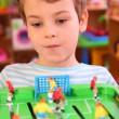 Boy plays in toy football — Stock Photo #7423434