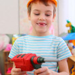Boy in plastic helmet with toy drill — Stock Photo