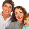 Stock Photo: Family of three with drawings on child face