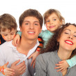 Family of four with drawings on children's faces — Stock Photo #7423442